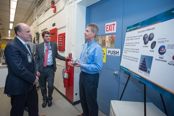 Savannah River National Laboratory Senior Fellow Scientist Bob Pierce (right) explains the research he is conducting for processing graphite fuel to Under Secretary for Science Paul Dabbar (left) and Taylor Playforth of DOE Congressional Affairs.