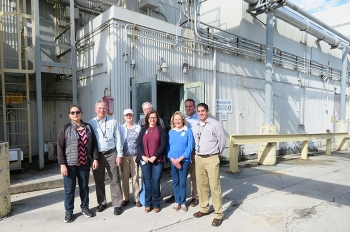 Federal Project Director Bill McMillan (second from left) led the tour at Oak Ridge National Laboratory, where participants are pictured in front of Building 3028.