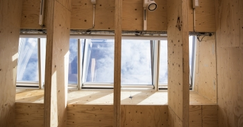 Photo of windows being installed in new construction.