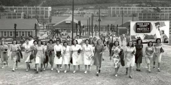 1945: Women finish their shift at Y-12 National Security Campus. More than 22,000 workers clocked in and out every day.