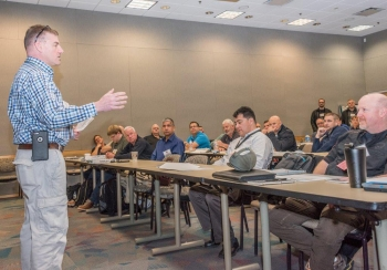 RAPTER coordinator Kent Gray, the federal team leader for RAP region 4, talks to participants at this month's training in Las Vegas.