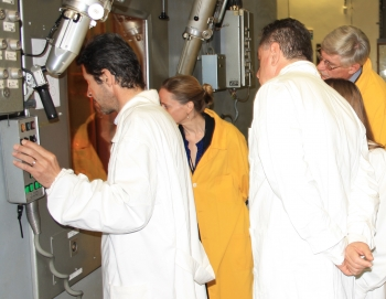 RATEN Institute engineers and NNSA experts observe process to safely remove high-activity radioactive sources prior to disposal.