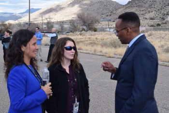 Office of Secure Transportation Assistant Deputy Administrator Vince Fisher, right, discusses the OST mission with Dr. Beatriz Cuartas, left, and an NNSA First Year participant.