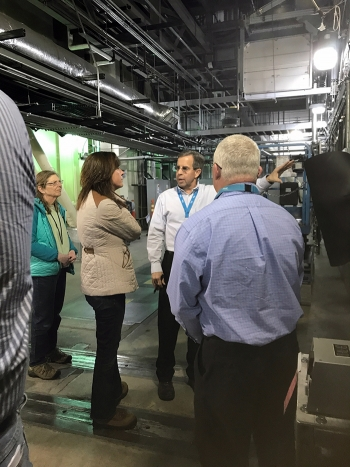 Integrated Waste Treatment Unit (IWTU) Operations Manager Craig Olson explains recent modifications to IWTU components to EM Assistant Secretary Anne Marie White during a tour of the facility.