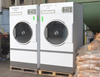 Shown are two of four excess government-owned commercial dryers to benefit clients of the Merryman House Domestic Crisis Center in Paducah.