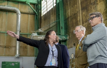 At the largest source of groundwater contamination at the Paducah Site, April Ladd of EM's PPPO describes ongoing deactivation and remediation projects related to the C-400 Cleaning Building to Sen. Mitch McConnell (center) and Secretary Rick Perry.