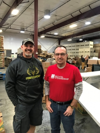 Mission Support Alliance President Bob Wilkinson, left, and Bechtel Waste Treatment and Immobilization Plant Project Director Brian Reilly helped pack more than 6,100 Bite2Go food kits.