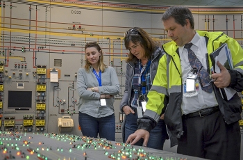 Brad Pont of PPPO explains the functions of the Paducah C-300 Central Control Facility to EM Assistant Secretary Anne Marie White (center) as she toured the Paducah Gaseous Diffusion Plant site last week. Pictured at right is Allison Finelli of EM HQ.