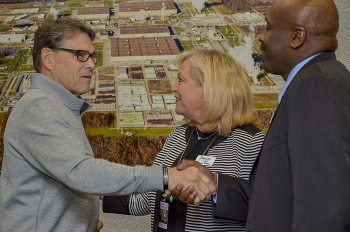 Paducah City Commissioner Sandra Wilson introduces Secretary Rick Perry to Dr. Anton Reece, president of West Kentucky Community and Technical College, during a community leaders meeting following a tour of the Paducah Site.