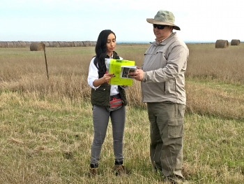 Director Melendez confers with LM's Tashina Jasso during a visit to the Falls City, Texas, Disposal Site.