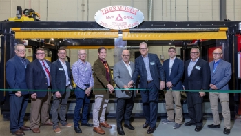 Moe Khaleel, center (left) ORNL Associate Laboratory Director, Energy and Environmental Sciences Directorate and Bob Vanderhoff, center (right) CEO, Magnum Venus Products, cut the ribbon on MVP's thermoset printer at DOE's Manufacturing Demonstration Faci
