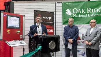 Blake Marshall, Manager, MDF, AMO speaks to attendees at the MVP thermoset printer ribbon-cutting (at right, Craig Blue, Director, ORNL, Energy Efficiency and Renewable Energy Programs and Moe Khaleel, ORNL Associate Laboratory Director, Energy and Enviro