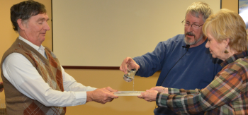 Dr. Mike Kemp (center) demonstrates variables affecting water flow with different types of soil, with Renie Barger (right) and Dr. Bill Murphy.