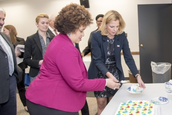 NNSA Administrator Lisa E. Gordon-Hagerty and Mid-Level Leadership Development Program graduate Erika Sesay cut the cake at a reception for the mid-career leaders.