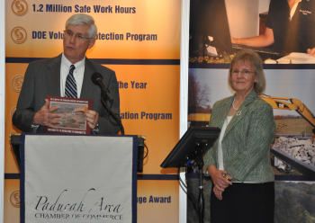 CAB Member Judy Clayton (right) was project leader in an effort that resulted in the 2013 publication of a book that captures the history of DOE's Paducah site.