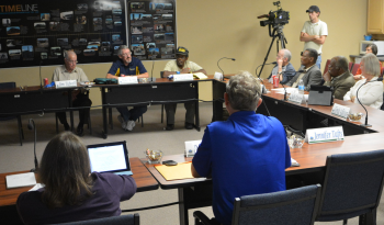 The CAB Board is shown during a 2013 meeting discussion.