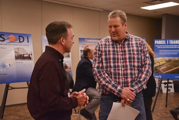 Dr. Jason Lovins with deactivation and decommissioning contractor Fluor-BWXT (left) discusses future use of EM's Portsmouth Site with Portsmouth Mayor Kevin Johnson last week at a community open house in Scioto County, Ohio