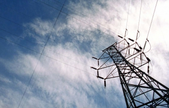 Close-up of an electrical transmission tower.