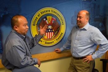 Anh Nguyen, left, talks to OST Deputy Assistant Deputy Administrator Kerry Clark.