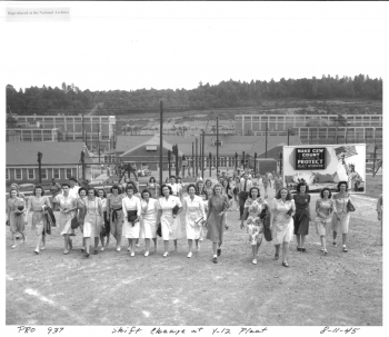 Many of the workers in the three Secret Cities of the Manhattan Project were young women. The group seen here is leaving the Y-12 plant, where uranium was enriched through electromagnetic separation.