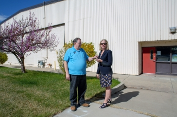 G. Earle Gardner, Area Facility Operations Specialist for U.S. Army Reserve contractor Versar, hands over keys to Building 7 in Grand Junction, Colorado, to Polly Robinson, Realty Specialist with the U.S. Department of Energy Office of Legacy Management.
