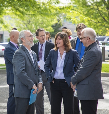 EM Assistant Secretary Anne White (center) talks with Rep. Dan Newhouse (left) and EM Richland Operations Office Manager Doug Shoop at the grand opening ceremony of the Hanford Workforce Engagement Center May 3 in Richland, Wash.