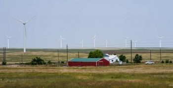 Farm with a wind turbine.