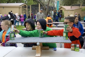 Students work with one of several simple machines on display at Fluor Idaho's learning station.