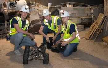 Left to right, Carlsbad High School science and engineering students Simon Armijo, Will Baggett, and Spencer Pennypacker test a robot in the Waste Isolation Pilot Plant underground in early May in preparation for an international robotics competition.