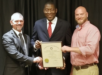 Swift & Staley Team (SST) award presentation, left to right: SST Environment, Safety and Health Manager John Hobbs; Kentucky Labor Secretary Derrick Ramsey; and SST United Steel Workers Safety Representative Jason Gilbert.