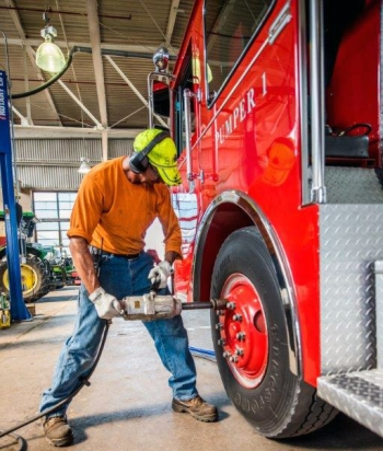 Swift & Staley Team Heavy Equipment Mechanic Bill Jackson performs maintenance on a Paducah Gaseous Diffusion Plant firetruck.