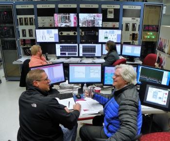 KRUSTY control room during the full-power run, Marc Gibson (GRC/NASA) and David Poston (LANL/NNSA) in foreground, Geordie McKenzie (LANL/NNSA) and Joetta Goda (LANL/NNSA) in background.