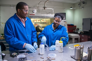Chemar Huntley, right, postdoctoral research associate and her mentor, Savannah River National Laboratory's Aaron L. Washington II, left.