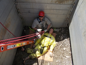 Eric Fuller of CH2M HILL BWXT West Valley takes his turn rescuing a 185-pound mannequin from the excavation pit during confined space training.