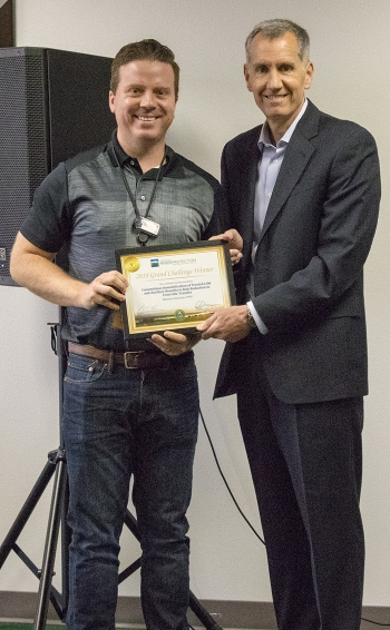 EM Office of River Protection Manager Brian Vance, right, presents a certificate to Matthew Asmussen of Pacific Northwest National Laboratory, whose team won this year's Grand Challenge competition.