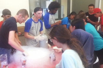High school students learn about the properties of liquid nitrogen at Energy Day
