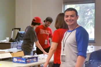 Undergraduate students set up a fuel cell car activity at UNM