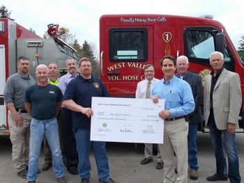 Donation to West Valley Fire, back row, left to right: Kevin Murray, West Valley Volunteer Fire Company chief; Tom Fontaine, CHBWV manager, radiological and industrial safety; Bryan Bower, EM WVDP site director; Paul Bembia, NYSERDA director; Jeff Bradfor