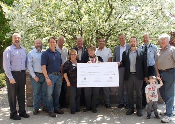 Donation to BCH, back row, left to right: Bryan Bower, EM WVDP site director; Ken Whitham, CHBWV, vice president, environmental, safety, health and quality; Scott Anderson, CHBWV deputy general manager; Jeff Bradford, CHBWV president and general manager;