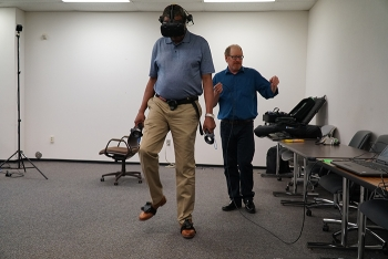 Savannah River Remediation (SRR) training specialist Julius Myers demonstrates a virtual reality program SRR is using to aid in slips, trips, and falls training.