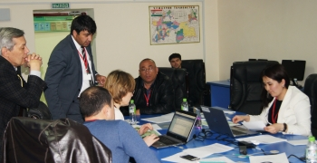 Participants strategize on best course of action in response to a simulated scenario related to nuclear material smuggling at the NNSA/NSDD workshop in Tajikistan.