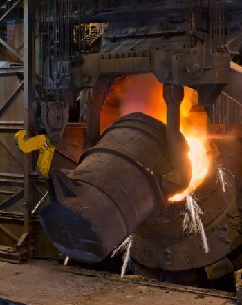 a photo of steel being smelted on an industrial scale.