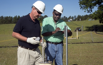 John Bradley, design authority engineer, left, and Joao Cardoso-Neto, Upper Three Runs project manager, both of Savannah River Nuclear Solutions, inspect a BaroBall unit.