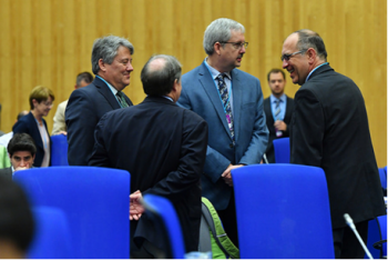 On May 21, 2018, Department of Energy managers converse with a delegate from the Czech Republic before the Opening Plenary session of the Sixth Review Meeting of the Joint Convention.