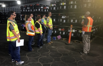 Fluor Idaho interns receive a briefing on transuranic waste shipping during a recent site tour.