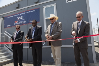 Officials cut the ribbon to open a new building and nuclear security mission for Y-12 National Security Complex: the NBL Center.