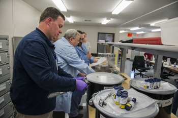 Workers prepare a shipment in Y-12 National Security Complex's new NBL Center. The center provides special nuclear certified reference samples internationally.