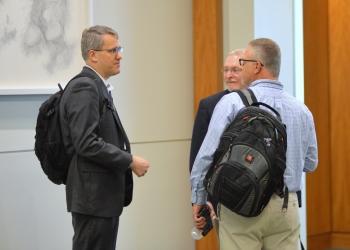 IT Governance & Enterprise Architect Jon Arlotti-Parish discusses IT issues with colleagues at NLIT.