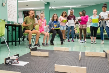Participants in the CodeGirls@Argonne camp test their code by maneuvering a robot through a maze.