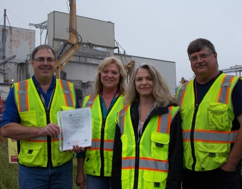 CH2M HILL BWXT West Valley Regulatory Strategy team members, Jerry Hoch, Janice Williams, Kim Mansfield, and David Klenk show the site's environmental management system program certificate issued by the International Organization for Standardization.